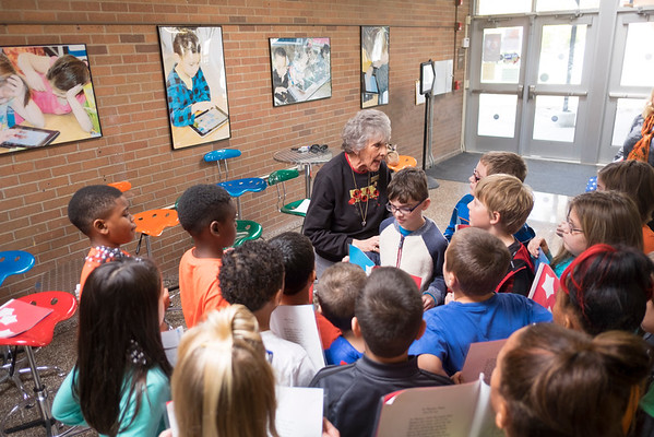 JOED VIERA/STAFF PHOTOGRAPHER-Lockport, NY-Renee Knight helps Roy B. Kelly students prepare for their event at Outwater Park on Veterans Day.