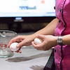 JOED VIERA/STAFF PHOTOGRAPHER-Niagara Falls, NY- Taste of Home Culinary Specialist Amy Zarichnak shows the audience how to crack eggs at the Taste of Home Cooking School event held at Antonio's.