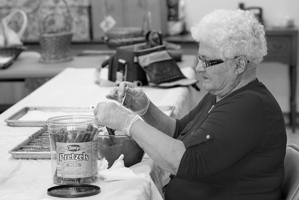 JOED VIERA/STAFF PHOTOGRAPHER-Lockport, NY-Judi Tracy makes chocolate covered pretzels at the Dale Association.