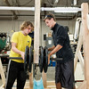 JOED VIERA/STAFF PHOTOGRAPHER-Newfane, NY- Newfane High School sophomore Derrick Holmes, 16, and freshman Caden Gibson, 15, add weights to the catapult.