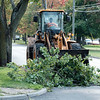 JOED VIERA/STAFF PHOTOGRAPHER-Lockport, NY-A crew removes a fallen tree limb on Beattie Avenue.