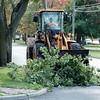 JOED VIERA/STAFF PHOTOGRAPHER-Lockport, NY-A crew removes a fallen tree limb on Beattie Avenue.