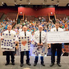 JOED VIERA/STAFF PHOTOGRAPHER-Lockport, NY- Starpoint students stand behind as Niagara County Sheriffs Department Cpt. Todd Ostrowski, Director Mark Kasprzak, Lt. Robert Richards, Undersheriff Mike Filicetti, Sheriff James Voutour and Deputy Craig Beiter hold up thank you cards and a check given to the department by the students in celebration of Lockport Blue.