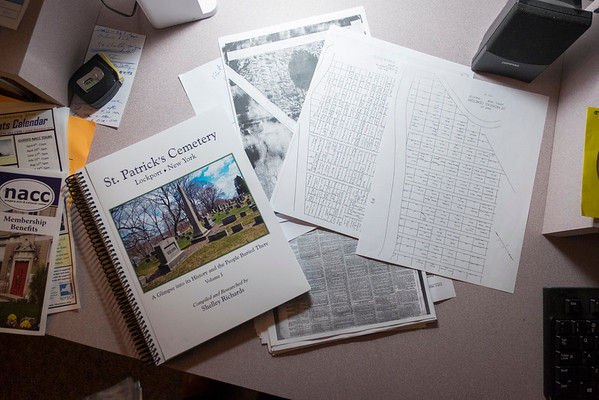 JOED VIERA/STAFF PHOTOGRAPHER-Lockport, NY-Materials going in Shelley Richards upcoming book about St. Patricks Cemetary are laid across a desk as its designed.