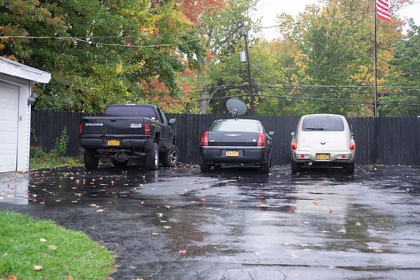 JOED VIERA/STAFF PHOTOGRAPHER-Lockport, NY- Cars parked outside of 605 High Street.
