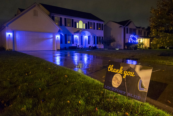 JOED VIERA/STAFF PHOTOGRAPHER-Lockport, NY- Former Ploice Chief Larry Eggerts house is lit blue in honor of Lockport Blue,