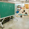 JOED VIERA/STAFF PHOTOGRAPHER-Newfane, NY- Construction for Newfane High School's catapult is underways, the device stands next to a chalkboard with catapult math.
