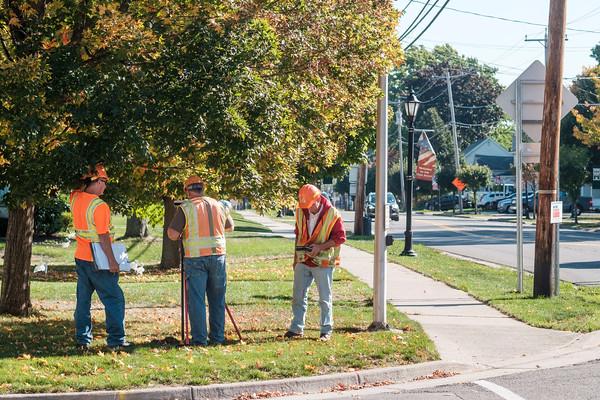 JOED VIERA/STAFF PHOTOGRAPHER-Newfane, NY- Surveyors work on Main Street's construction.