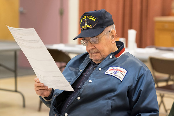 JOED VIERA/STAFF PHOTOGRAPHER-Lockport, NY-Joseph Schubauer looks over United Healthcare documents during a medicare informational session at the Dale Association.