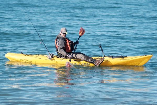 JOED VIERA/STAFF PHOTOGRAPHER-Olcott, NY-Brian Porter kayaks on Lake Ontario to fish.