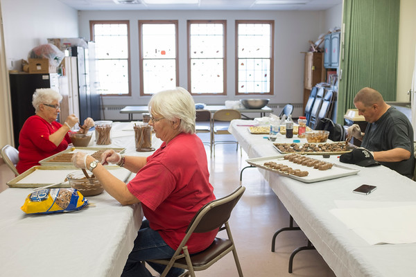JOED VIERA/STAFF PHOTOGRAPHER-Lockport, NY-Judi Tracy, Linda Sawyer and Mark Moller make chocolate confectionery at the Dale Association.