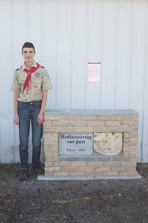 JOED VIERA/STAFF PHOTOGRAPHER-Newfane, NY- Scout Scott Zeitz stands by a tombstone he installed.