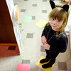 JOED VIERA/STAFF PHOTOGRAPHER-Lockport, NY-Enola Starkweather, 5, dressed as a cat plays candyland during the Barge Canal Optimist Club's Happy House at the YMCA.