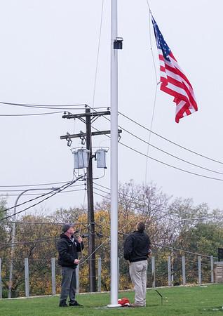 JOED VIERA/STAFF PHOTOGRAPHER-Lockport, NY-An American flag was retired at Cornerstone Arena by Ben Maziarz and Baxter Sukdolak.
