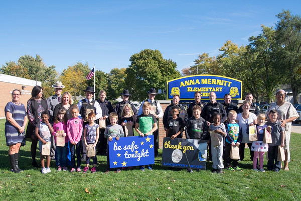 JOED VIERA/STAFF PHOTOGRAPHER-Lockport, NY- Anna Merritt students pose with local law enforcment officers from the Niagara County Sheriffs Department, Lockport Police and State Police after giving them goodie bags made in celebration of Lockport Blue.