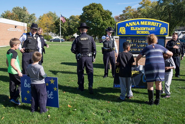 JOED VIERA/STAFF PHOTOGRAPHER-Lockport, NY- Anna Merritt students greet local law enforcment officers from the Niagara County Sheriffs Department, Lockport Police and State Police before giving them goodie bags made in celebration of Lockport Blue.
