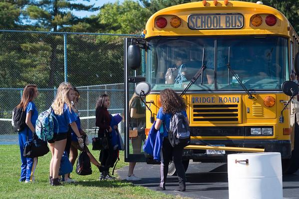 JOED VIERA/STAFF PHOTOGRAPHER-Lockport, NY-Lockport High School students board a Ridge Road Express schoolbus outside of the school.