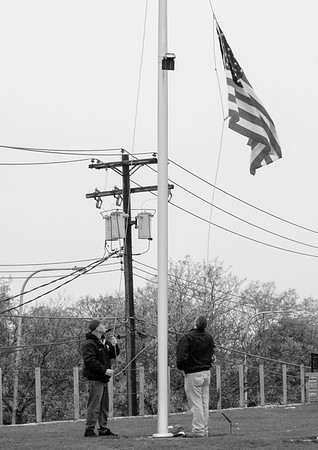 JOED VIERA/STAFF PHOTOGRAPHER-Lockport, NY-An American flag was retired at Cornerstone Arena by Ben Maziarz and Baxter Sukdolak.
