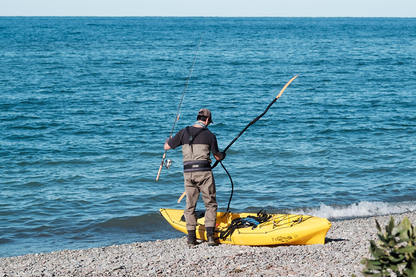 JOED VIERA/STAFF PHOTOGRAPHER-Olcott, NY-Brian Porter prepares to kayak on Lake Ontario to fish.