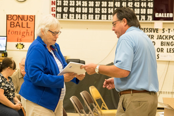 JOED VIERA/STAFF PHOTOGRAPHER-Lockport, NY-Jean Snyder speaks with United Healthcare representative Carl Mayer about their open enrollment for medicare at the Dale Association.