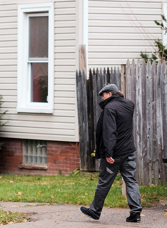 JOED VIERA/STAFF PHOTOGRAPHER-Lockport, NY-    Edwin Melendez, a tenant that had to leave his residence Friday morning scratches his head as he walks away from his apartment on Cottage Street after checking to see if he was allowed to re-enter.