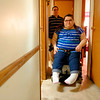 JOED VIERA/STAFF PHOTOGRAPHER- Lockport, NY-John Constantin and hs disabled daughter Destiny show the narrow hallway the wheelchair bound 22 year old struggles to fit through.
