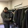 Contributed-Lockport, NY-Marine Corps Veteran Michael Grimmer browses throught the selection of suits  at the One-Stop Veterans Center.