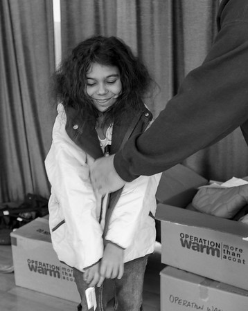JOED VIERA/STAFF PHOTOGRAPHER-Lockport, NY-  Lillian Brister tries on her new coat at Charles Upson.