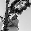 JOED VIERA/STAFF PHOTOGRAPHER-Lockport, NY- Randy Szymanski decorates a light fixture with a wreath up on Main Street.