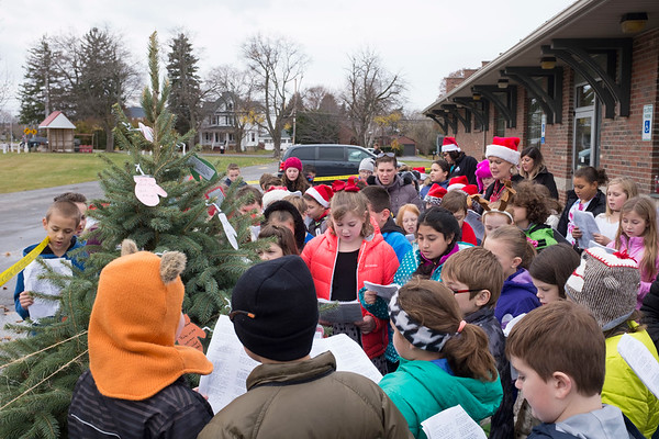 JOED VIERA/STAFF PHOTOGRAPHER-Gasport, NY-Roy-Hart students caroll by the  Christmas tree in front of the Gasport Post Office.