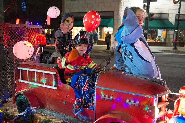 JOED VIERA/STAFF PHOTOGRAPHER-Lockport, NY-   Kids wave on thier fire engine float while riding in the Light Up Lockport Parade.