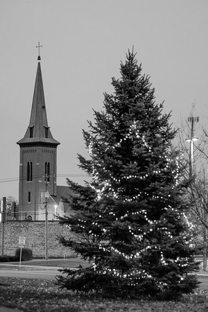 JOED VIERA/STAFF PHOTOGRAPHER-Lockport, NY- St. Mary's steeple towers over downtown Lockport as lights adorn the pine at Ida Fritz park during.