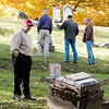 JOED VIERA/STAFF PHOTOGRAPHER-Lockport, NY- Dennis Devine speaks with the US&J by the Whitcher Civil War Monument as Frank Rose, Randy Kaiser and Mark Devine chat about gravestones at Glenwood Cemetary.