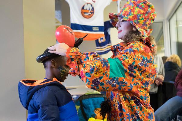 JOED VIERA/STAFF PHOTOGRAPHER-Lockport, NY-    Flora the Clown places a balloon helmet on Jeremiah Doran, 9, during Hockey Day at Cornerstone Arena.