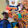 JOED VIERA/STAFF PHOTOGRAPHER-Lockport, NY-    Flora the Clown places a balloon helmet on Jeremiah Doran, 9, during Hockey Day at Cornerstone Arena.