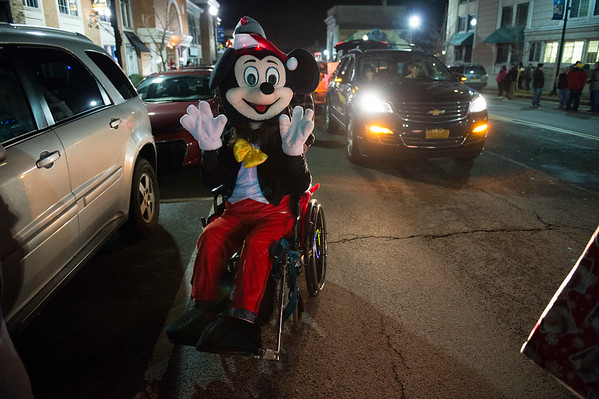 JOED VIERA/STAFF PHOTOGRAPHER-Lockport, NY-   Mickey Mouse rides in his wheelchair during the Light Up Lockport Parade.