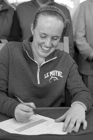 JOED VIERA/STAFF PHOTOGRAPHER-Newfane, NY-Olivia Littman, 17, signs her   letter of intent to play D2 Softball at LeMoyne College.