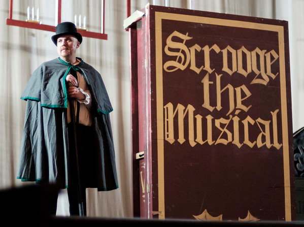 JOED VIERA/STAFF PHOTOGRAPHER-Lockport, NY-Jay Zimmerman rehearses the role of Ebenezer Scrooge in the Palace Theatre's performance of Scrooge The Musical Tuesday night.