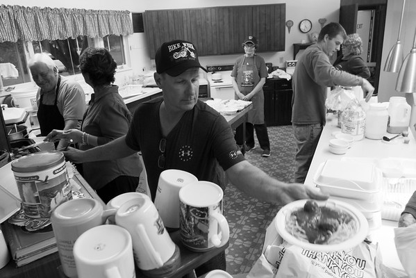 JOED VIERA/STAFF PHOTOGRAPHER-Somerset, NY-Mike Flint serves a plate of spaghetti at the Faith United Methodist  Church kitchen during their Election night dinner.