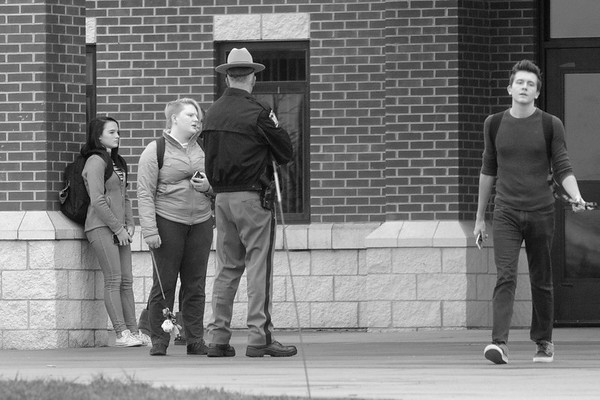 JOED VIERA/STAFF PHOTOGRAPHER-Pendleton, NY-A State Trooper speaks with students outside of Starpoint High School after a lock-out at the school.