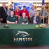 JOED VIERA/STAFF PHOTOGRAPHER-Newfane, NY-Olivia Littman, 17, signs her   letter of intent to play D2 Softball at LeMoyne College. Back row: Newfane superintendant Michael Baumann, athletics director Doug Ames, softball coach Katie Stedman, batting coach Jared Conlo, Amherst Lightning travel coach Earl Leising and Newline High School principal Dan Bedette.<br /> Front row: Cory Littman, Olivia Littman, 17, Laura Littman