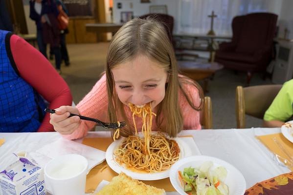 JOED VIERA/STAFF PHOTOGRAPHER-Somerset, NY-Jocelyn Schmitt, 8, enjoys a plate of spaghetti at the Faith United Methodist Church kitchen during their Election night dinner.