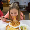 JOED VIERA/STAFF PHOTOGRAPHER-Somerset, NY-Jocelyn Schmitt, 8, enjoys a plate of spaghetti at the Faith United Methodist Church kitchen during their Election night dinner.