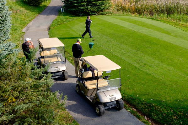 JOED VIERA/STAFF PHOTOGRAPHER-Lockport, NY-A group of golfers take advantage of Tuesday's weather.