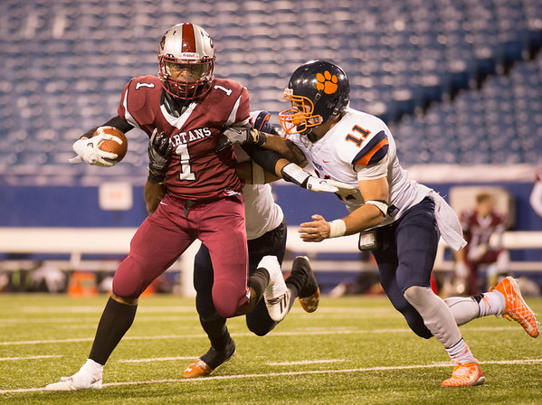 JOED VIERA/STAFF PHOTOGRAPHER-Orchard Park, NY-Spartans runningback Tajay Amhed battles through a tackle by Tigers' linebackers Jamal Lofton, 7 and Isaiah McDuffie, 11.