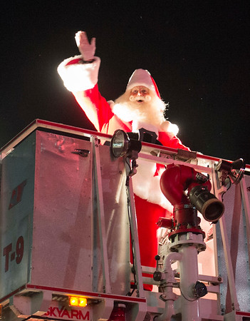 JOED VIERA/STAFF PHOTOGRAPHER-Lockport, NY-   Santa Clauss Lights Up Lockport during the parade in front of the Palace Theatre.