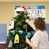 JOED VIERA/STAFF PHOTOGRAPHER-Lockport, NY-   Lisa Weaver-Sidor decorates the giving tree at the Lockport Department of Motor Vehicles.
