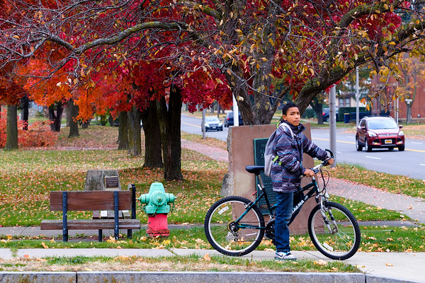 JOED VIERA/STAFF PHOTOGRAPHER-Lockport , NY-Jared Tennyson, 13, takes his bike out for a ride by the canal after getting out of Emmet Belknap Intermediate School