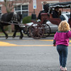 JOED VIERA/STAFF PHOTOGRAPHER-Lockport, NY-    Jordyn Kruse, 2, watches a horse carraige ride by on Main Street.