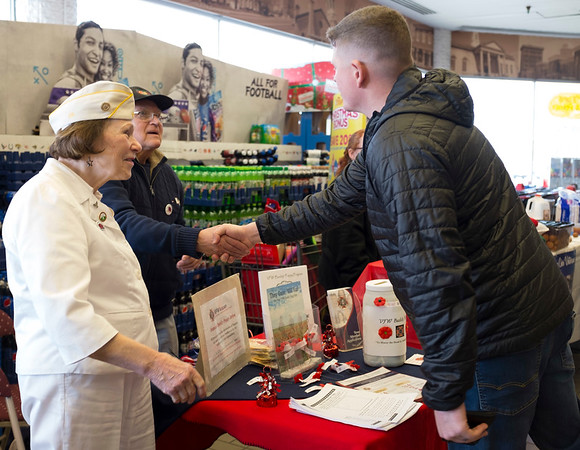 JOED VIERA/STAFF PHOTOGRAPHER-Lockport, NY-Active duty Army Lt. Matt Derosa thanks Ron and Shirley Weaver for their son's service after purchasing a poppy from the couple during the Poppy Drive at Top's on Transit Road.